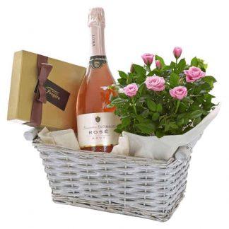 cesto de rosas pitiminí rosados, champagne y bombones
