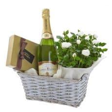 cesto de rosas pitiminí, champagne y bombones