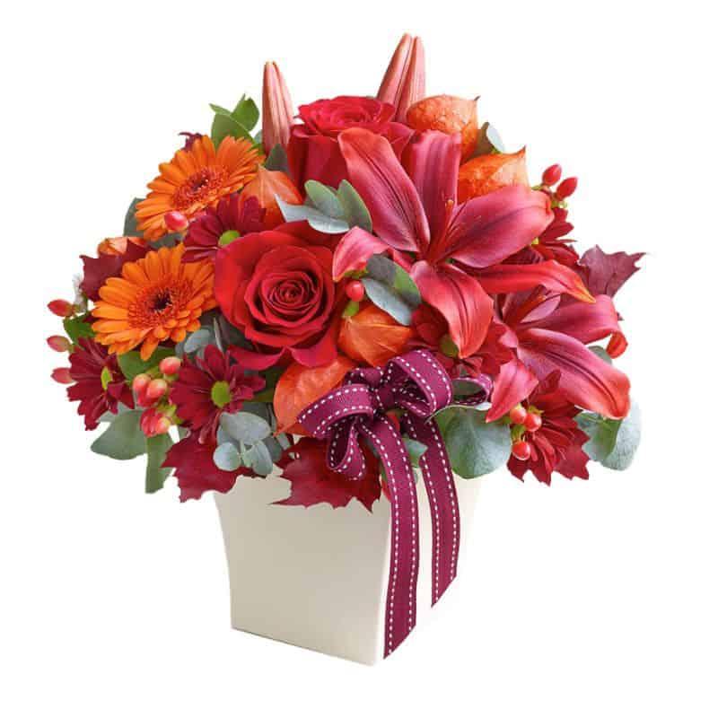centro de flores, centro de gerveras, rosas, lisianthum